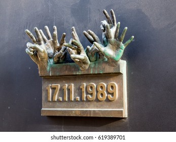 "PRAGUE, CZECH REPUBLIC-APRIL 10,2017: The Velvet Revolution Memorial on Národní street.The hands projecting from the plaque are showing a ""V,""which stands for victory and was a symbol of the movement."