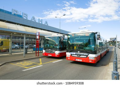 PRAGUE, CZECH REPUBLIC-APRIL 30, 2018: Two city buses at the bus stop near the Terminal 1 of the Vaclav Havel airport