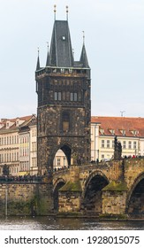 Prague, Czech Republic-February 02, 2019. Close up view of the Old Town Bridge Tower one of two bridge towers of the famous historical Charles bridge over the Vltava river in old Prague town.