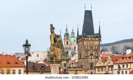 Prague, Czech Republic-February 02, 2019. View of the buildings tops and the Lesser Town Bridge Tower of the famous historical Charles bridge at old part of Prague town.