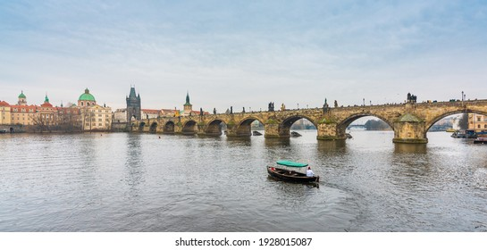 Prague, Czech Republic-February 02, 2019. View of the famous historical Charles bridge over the Vltava river and old town buildings in Prague 1.