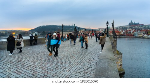 Prague, Czech Republic-January 31, 2019. View during the sunset of the famous, historical Charles bridge over Vltava river, walking street for the pedestrians and connection between to parts of Prague