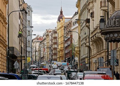 Prague, Czech Republic-May 9, 2019: Center of Prague. Side street of Wenceslas Square. Many cars shops and tourists.