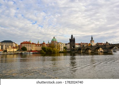 Prague, Czech Republic-October 2019; Close up view of the Charles bridge with Old Town Bridge Tower, St. Francis Of Assisi Church and Klementinum complex