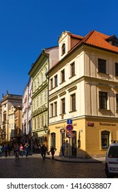 Prague, Czechia - April 24, 2019: Street scene from the Old Town in Prague with a corner restaurant / microbrewery