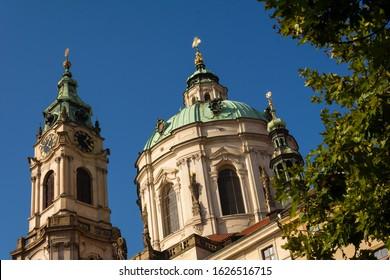 Prague, Czechia - January 3, 2020: St. Nicholas Church in Prague. The Church of Saint Nicholas (Czech: Kostel svatého Mikulase) is a Baroque church in the Lesser Town of Prague – Mala Strana.