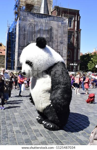 PRAGUE, CZECHIA - JULY 1, 2018: Street performance in a pneumatic panda costume in Prague city center
