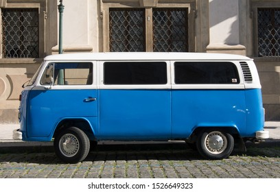 Prague, Czechia - July 6, 2017: White/Blue Volkswagen Bus T2 Transporter. Blue Hippie VW bus with white top. Vintage classic van.