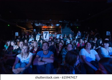 PRAGUE, CZECHIA - MARCH 25, 2017: Audience crowds at theater live show of Poetry Slam exhibition public event, votign and showing marks