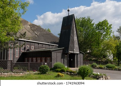 Prague, Czechia - May 26 2020: Wooden church of the Evangelical Church of Czech Brethren in a former limestone quarry in Prague-Branik. Built in 1948 as an interim building and expanded in 2016.