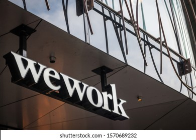 PRAGUE, CZECHIA - NOVEMBER 2, 2019: Wework logo in front of their office in Prague. Wework is an American real estate company specialized in coworking spaces currently facing financial issues.