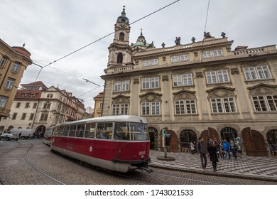 PRAGUE, CZECHIA - NOVEMBER 2, 2019: Tram passing by the stop of Malostranske Namesti Square, in the Mala Strana district, one of the most touristic spots of the Old town of Prague.