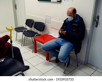PRAGUE, CZECHIA - A patient with kn95 respirator is waiting to see a doctor (general practitioner) in a clinic waiting area. Mar 11, 2021