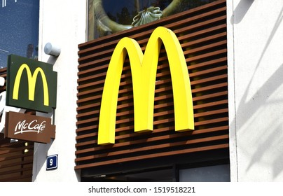PRAGUE / CZECHIA - SEPT. 2019: Logo of 'Mc Donalds' and 'Mc Café' on a storefront in the centre of Prague. McDonald's is the world's largest restaurant chain, daily serving over 69 million customers.