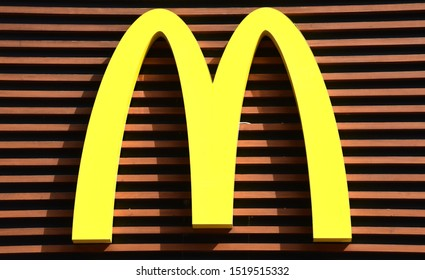 PRAGUE / CZECHIA - SEPT. 2019: Yellow logo of 'Mc Donalds' on a storefront in the centre of Prague. McDonald's is the world's largest restaurant chain, daily serving over 69 million customers.