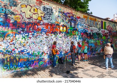 PRAGUE, CZECHIA - SEPTEMBER 05: John Lennon Wall with unidentified people on September 05, 2015 in Prague. Since the 80s the wall has been filled with Lennon graffiti and lyrics from Beatles songs