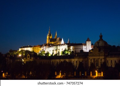 PRAGUE, CZECHOSLOVAKIA-AUGUST 29; Night view across Vitava river, and reflections, of Prague Castle, Czechoslovakia. AUGUST 29 2017, Prague, Czechoslovakia.