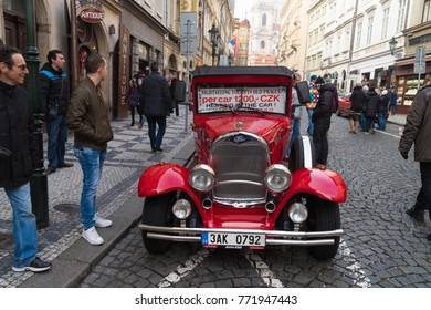 PRAGUE - DECEMBER 29, 2016: Vintage red car waiting for tourists for a guided city tour