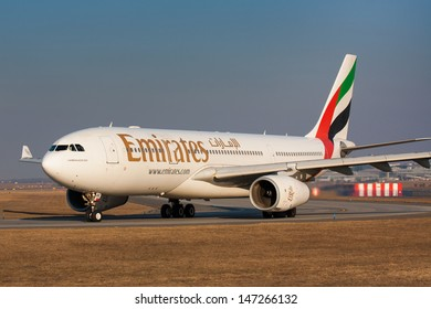 PRAGUE - FEBRUARY 26: Emirates Airbus A330 airliner taxes for take off on February 26, 2011 in Prague,Czech Republic. Emirates is rated as a top 10 best airlines in the world flying on youngest fleet.