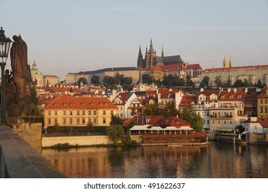 Prague Hradcany castle and St Vitus Cathedral in early morning  on Vltava River in  Prague, Czech Republic