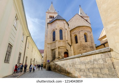 PRAGUE, HRADCANY DISTRICT / CZECH REPUBLIC - SEPTEMBER 29, 2018: Romanesque style St. George Basilica (9th cent.) apses and spires, part of Benedictine convent. Prague Castle.