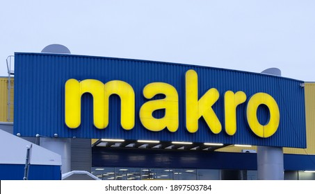 """PRAGUE - January, 2021: Makro Cash and Carry wholesale supermarket store with many branches. Shop and the logo of the """"MACRO"""" in the Czech Republic."""