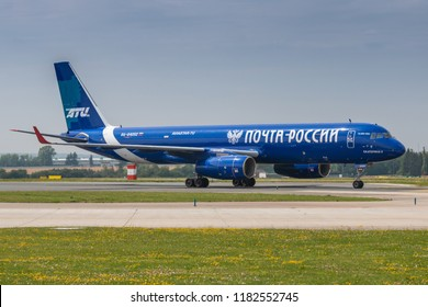 PRAGUE - JULY 06: Aviastar-TU Tupolev Tu-204 cargo taxis after landing at PRG Airport on July 6, 2018 in Prague, Czech Republic. Aviastar-TU is a passenger and cargo charter airline.