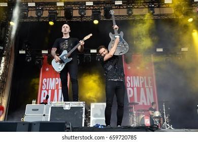 PRAGUE - JUNE 11: Guitarists Jeff Stinco (left) and Sebastien Lefebvre (right) of Simple Plan during performance at Aerodrome festival in Prague, Czech republic, June 11, 2017.