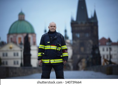 PRAGUE - JUNE 2: Firefighter on closed Charles Bridge. The Czech Capital is on high alert as a swell of floodwater moves in from the south on June 2, 2013 in Prague, Czech Republic.