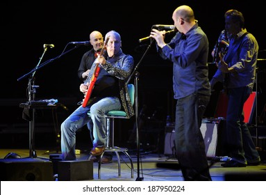 PRAGUE - JUNE 26: Famous British guitarist Mark Knopfler (sitting) during his performance in Prague, Czech republic, June 26, 2010.