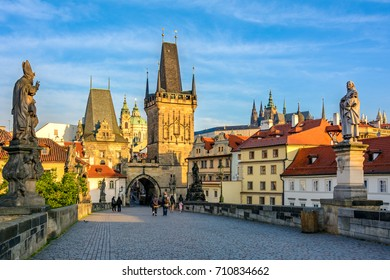 Prague main sights at dawn: Lesser Town Bridge Towers on Charles Bridge and Prague castel. Czech Republic, Bohemia