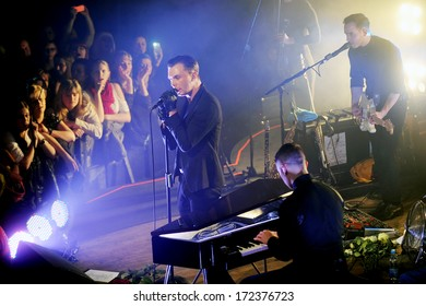 PRAGUE - MARCH 28: Singer Theo Hutchcraft (left) and synthesist Adam Anderson (right down) of The Hurts during performance in Prague, Czech republic, March 28, 2013.