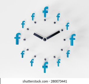PRAGUE - MAY 04, 2015: 3D printed facebook logos on white paper forming a clock. Facebook is a worldwide well-known social media networking website.