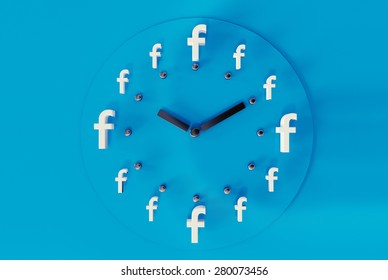 PRAGUE - MAY 04, 2015: 3D printed facebook logos on blue paper forming a clock. Facebook is a worldwide well-known social media networking website.