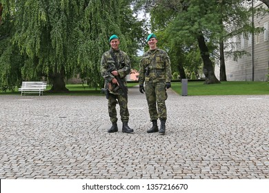 """Prague - May 17, 2016: Military counterterrorism patrol in Prague Castle, armed with a rifle """"CZ-805 Bren"""" and pistol """"CZ P-09"""""""