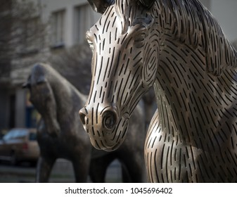 PRAGUE - MAY 3, 2017: Bronze sculptural group of horses from Michal Gabriel, mounted on a water cascade on the square between the streets of Kafka - Wuchterlova in Prague Dejvice.