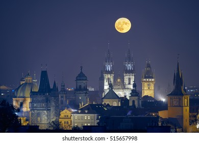Prague at night with the biggest full moon in last 68 years above historic church towers, captured on November 4th 2016