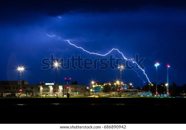 PRAGUE - Night view on Vaclav Havel Airport in Prague. Storm and lightning. Czech republic