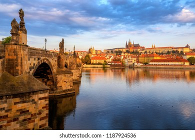 Prague Old Town, Charles Bridge, St Vitus Cathedral and Prague Castle, Czech Republic, reflecting in Vltava river on sunrise