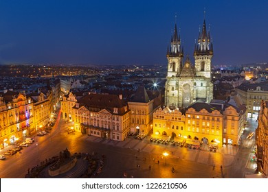 Prague - The Orloj on the Old Town hall, Staromestske square and Our Lady before Týn church at dusk.
