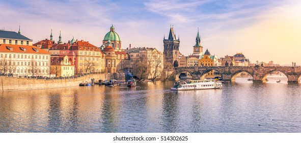 Prague panorama with its river and buildings - Panorama of Prague city, the capital of Czech Republic, with the Vltava river, the Charles Bridge and surrounding buildings, on a sunny day of March.
