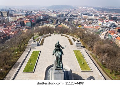 Prague panorama skyline aerial view with Jan Zizka equestrian statue from sculptor Bohumil Kafka (1878-1942) in front of National memorial Vitkov, Prague, Czech Republic, sunny day