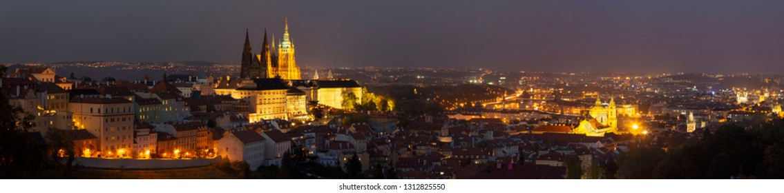 Prague - The panorama of the Town with the Castle and St. Vitus cathedral at dusk.
