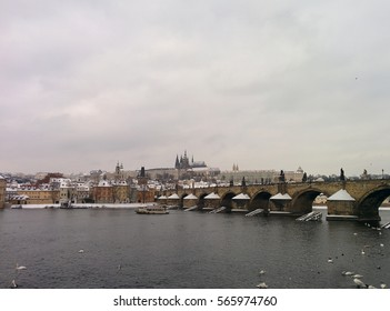 Prague panorama. Urban city. Winter in Prague. Prague castle. Charles bridge. Winter mood. Winter weather. Snowy weather. Snow in Prague. Cold theme.