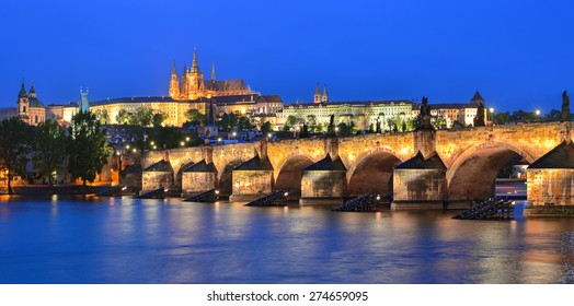 Prague. Panorama of the Vltava river, Charles Bridge and St. Vitus Cathedral at night. Karluv Most, Prazsky hrad. Czech Republic.