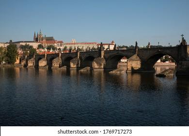 Prague Riverside and St. Vitus Cathedral and Charles Bridge on Vltava river