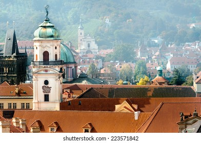 Prague, roofs of Clementinum jesuit college and Astronomical Tower on a misty day