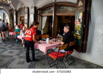 PRAGUE - SEP 1 , 2016 - Tourists enjoy lunch in an arcade restaurant  on Nerudova Street,  Prague, Czech Republic