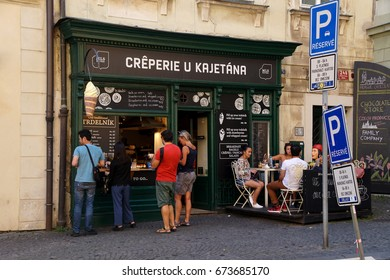 PRAGUE - SEP 1 , 2016 - Tourists order at a creperie  on Nerudova Street,  Prague, Czech Republic