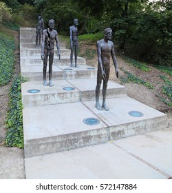 PRAGUE - SEP 5: Bronze statues honoring victims of communism on Sep 5, 2013 in Prague. Unveiled on May 22, 2002, it is located at the foot of Petrin hill, Ujezd street in Lesser Town (Mala Strana).